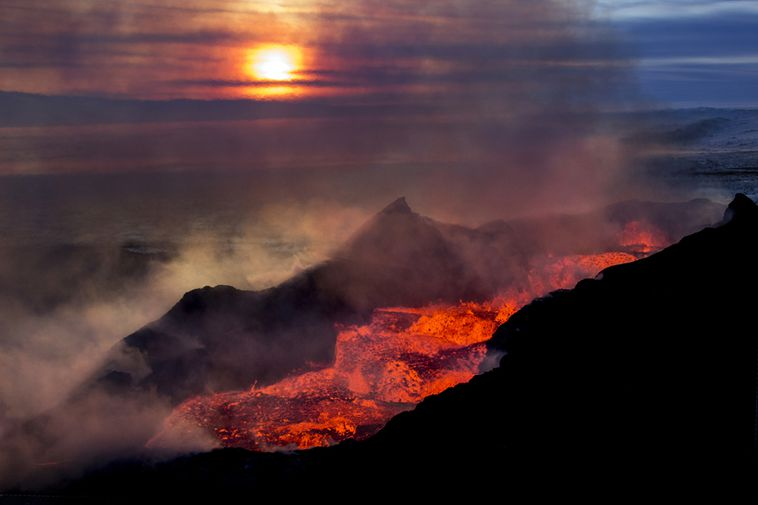 Ragnar Axelsson took this amazing photo of the sunrise over the lava field.