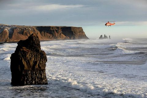 The National Coastguard helicopter searching for the woman today at Reynisfjara .