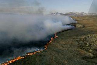 Guðni Ágústsson skoðaði í gær Mýrarnar þar sem stórt svæði brann í síðustu viku.