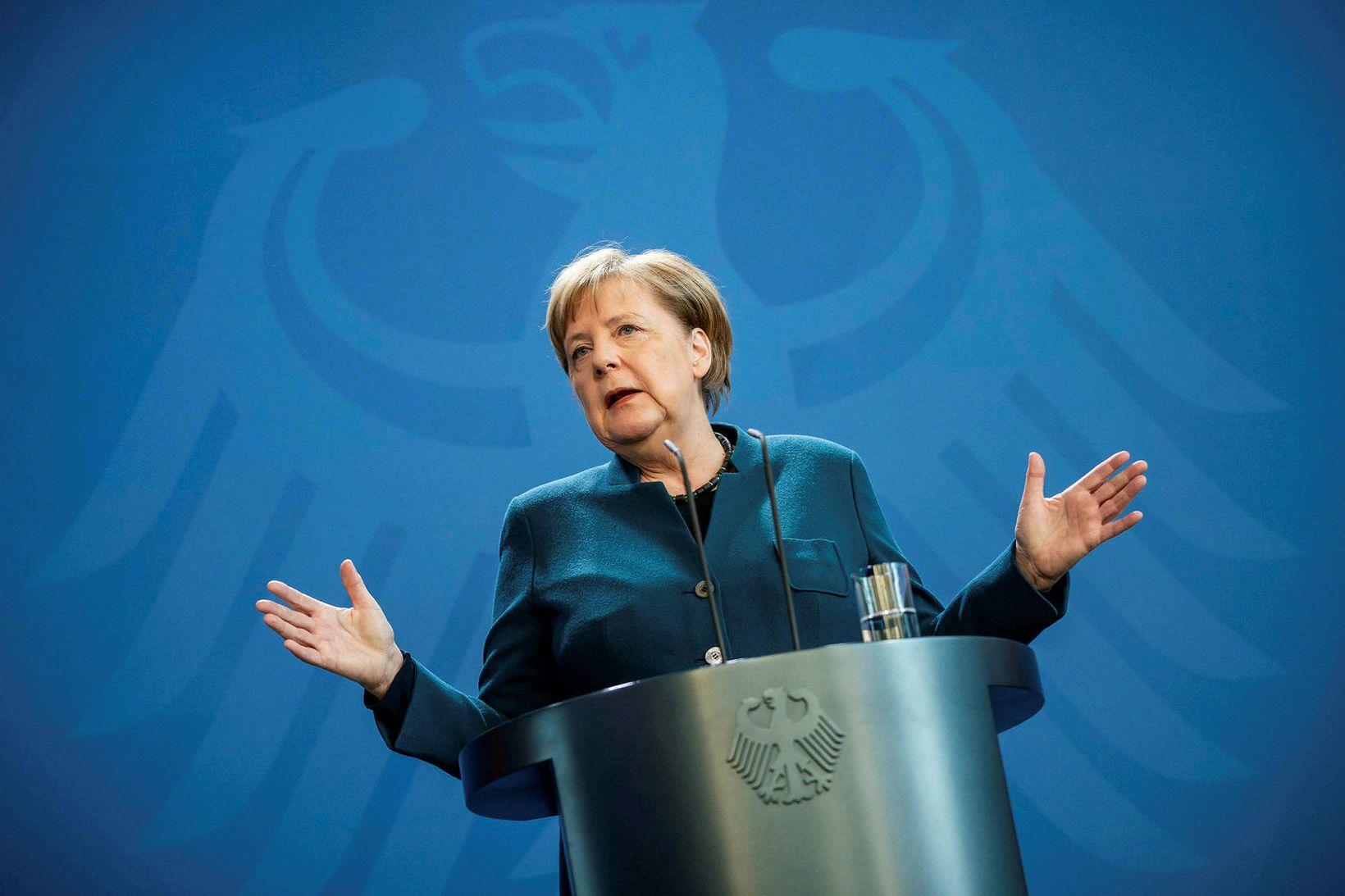 Angela Merkel á blaðamannafundi vegna veirunnar í mars.