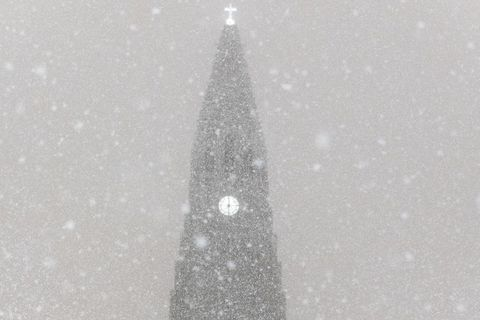 Hallgrímskirkja church, one of the city's landmarks, dusted with snowflakes.