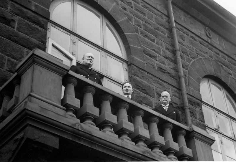 British PM Churchill addresses the crowd gathered in front of the parliamentary building.