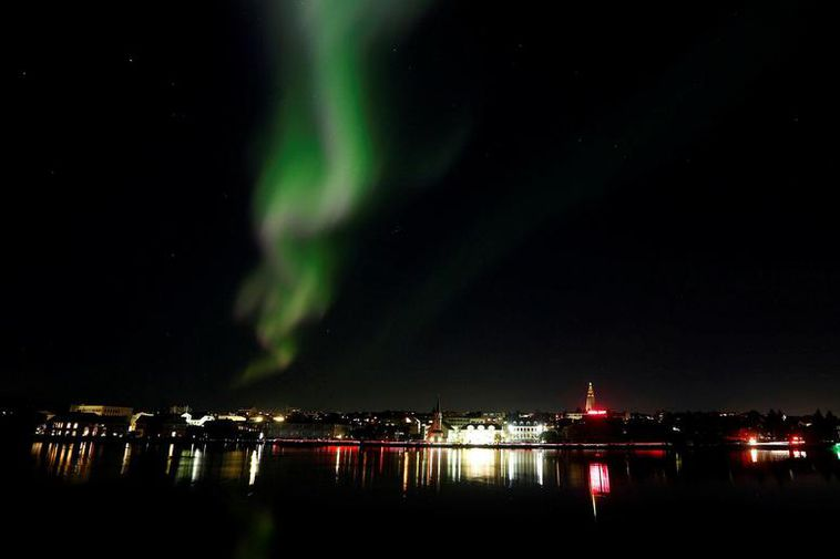 The Northern Lights dancing above Lake Tjörnin in the city centre last night.
