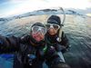 Jeff and Anna snorkelling in Silfra in the freezing cold.