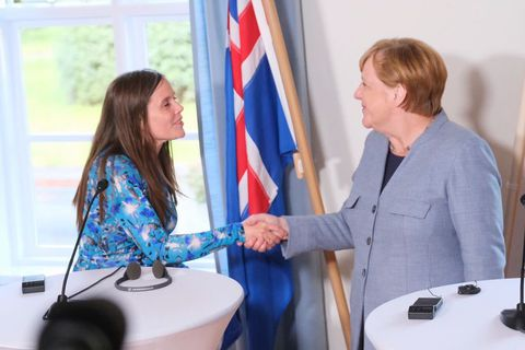 Prime Minister Katrín Jakobsdóttir and German Chancellor Angela Merkel shake hands.