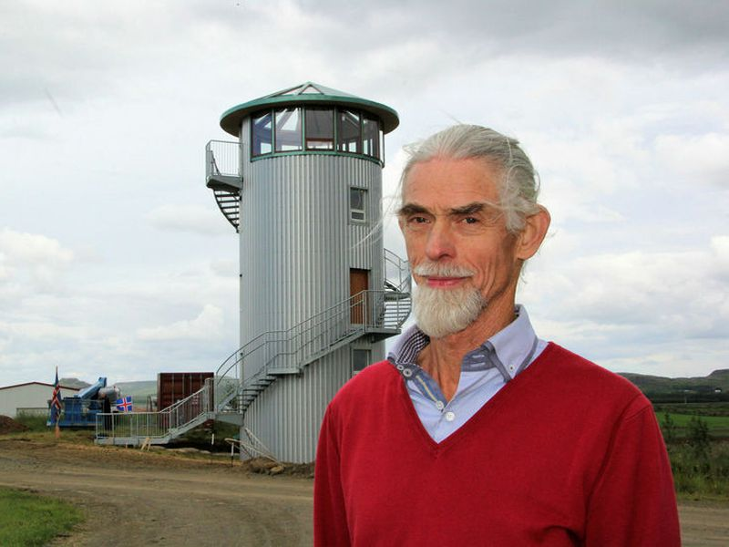 Ásgeir Eiríksson next to the silage tower which was built in 1957.