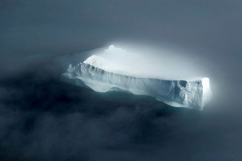 The majestic iceberg, looking mysterious in the fog. It is estimated that only one fifth to one-seventh of it is above sea level.