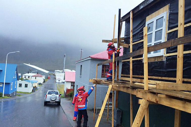 Rescue teams at work, securing scaffolding which was damaged in the storm.