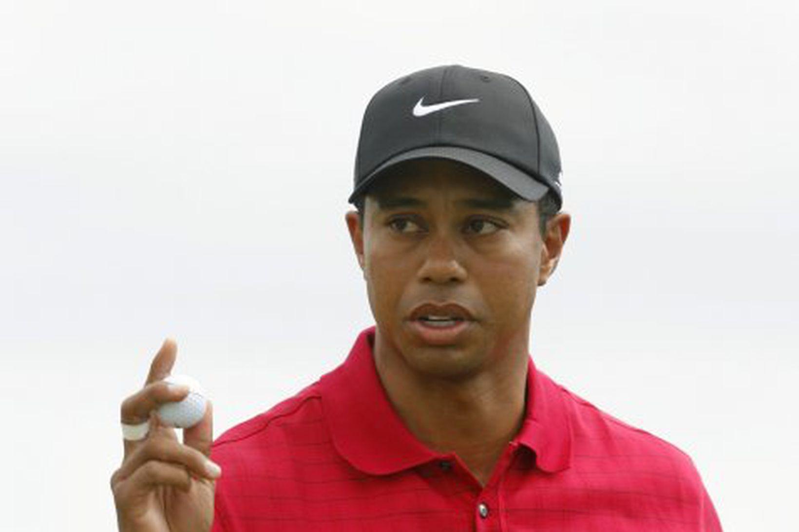Tiger Woods fagnaði sigri í dag á heimsmótinu í holukeppni.