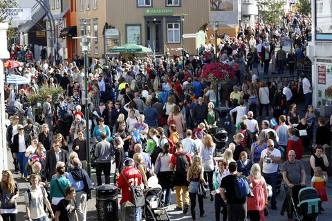 Crowds on Laugavegur in downtown Reykjavik.
