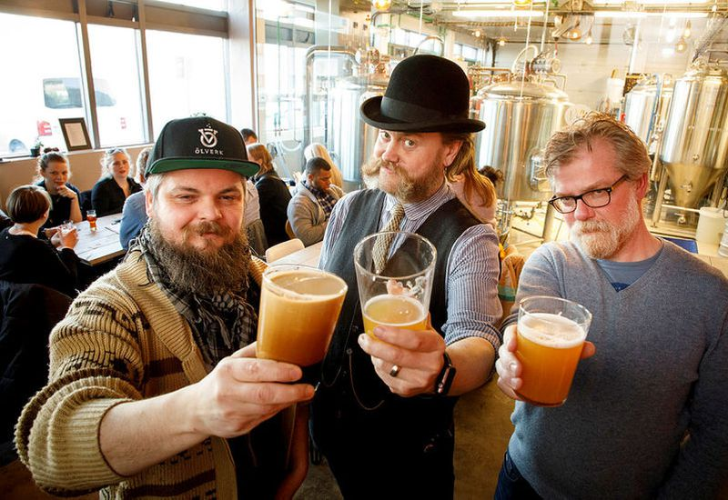 From RVK Brewing Co. From left: Nonni Quest, barber, Valgeir Valgeirsson brewer, and Sig­urður Pét­ur Snorra­son, co-owner of RVK Brew­ing Co.