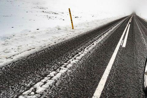 Snow in Fjarðarheiði mountain pass.
