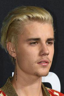 Þessi mynd er af Justin Bieber en ástralskur maður fékk fjölmörg börn til þess að ...
