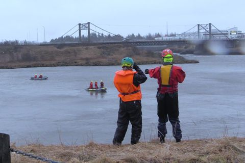 SAR team members searching the river yesterday.