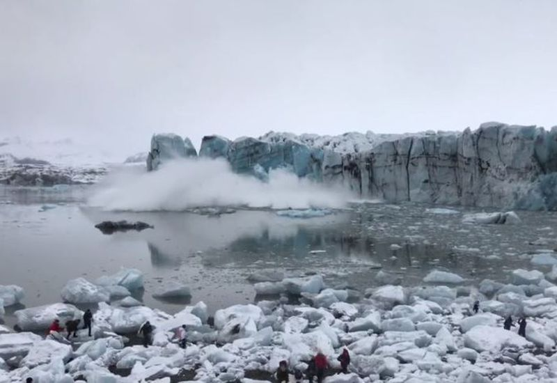 Tourists run for their lives as huge waves approach in Jökulsárlón glacial lagoon.