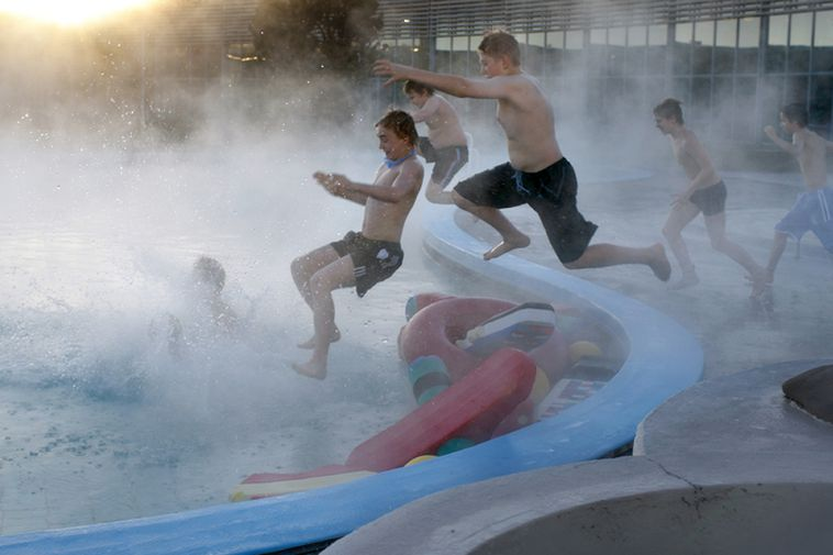Boys jumping into a Reykjavik swimming pool in the middle of winter.