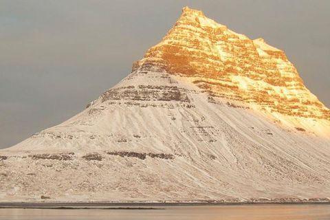 Mount Kirkjufell gilded by the sun.