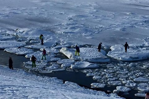 Irresponsible tourists iceberg-hopping in Iceland.