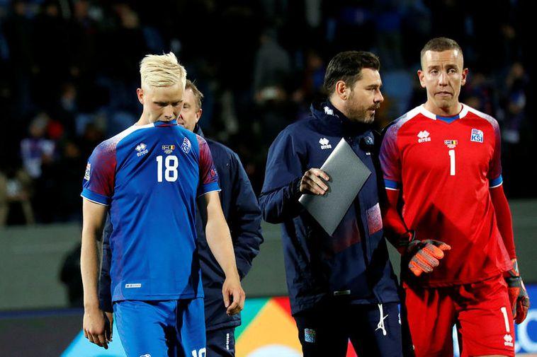Hörður Björgvin Magnússon, coach Freyr Alexandersson and goalkeeper Hannes Þór Halldórsson at the end of ...