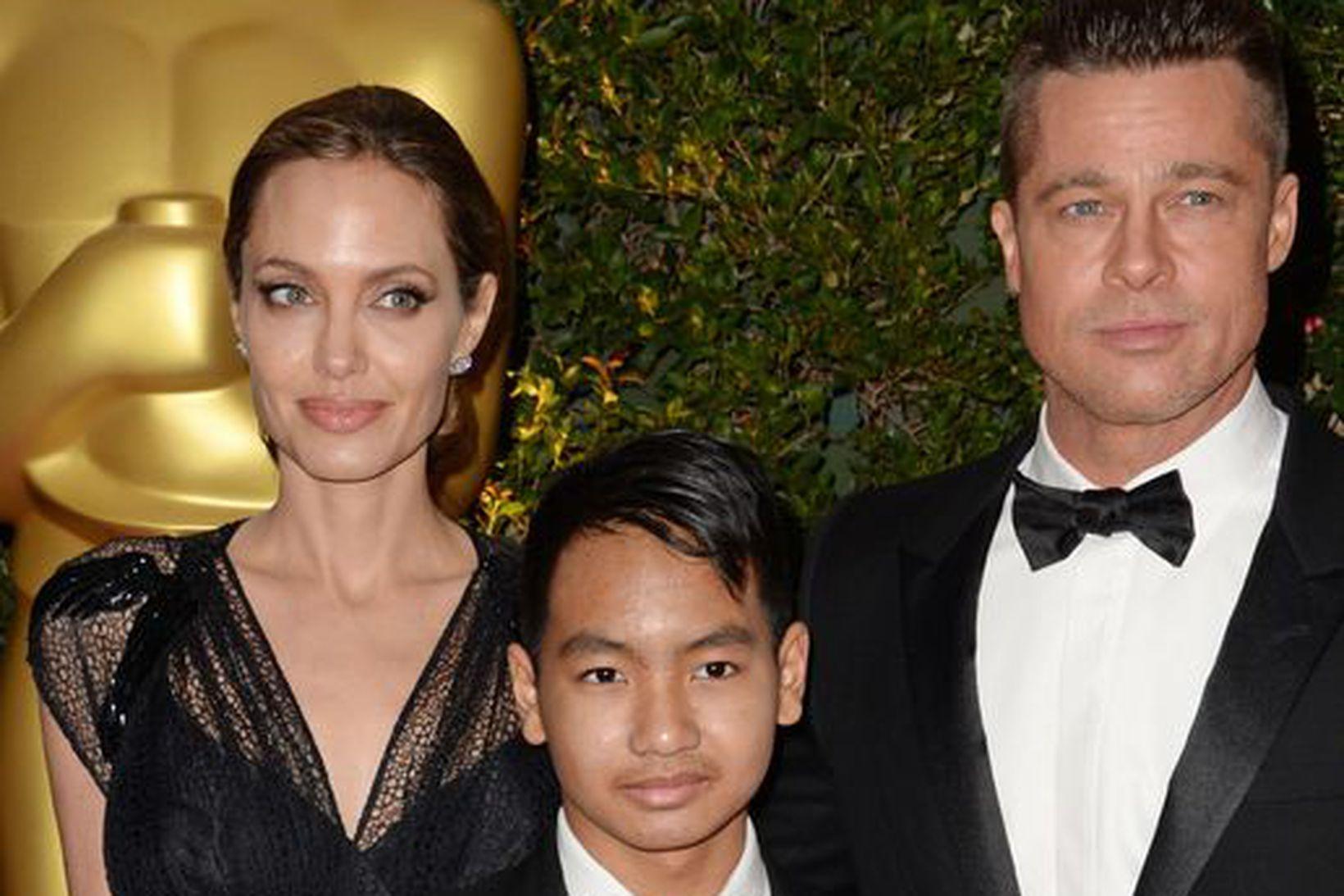 Maddox ásamt foreldrum sínum, Angelinu Jolie og Brad Pitt.