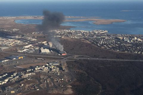 The fire seen from the air at 8.30 this morning.