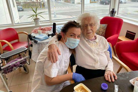 Helga Guðmundsdóttir, with a healthcare worker at Berg nursing home, Bolungarvík.