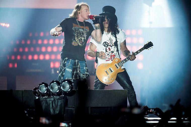 Vocalist Axl Rose and guitarist Slash performing at the Guns N' Roses concert at Parken ...