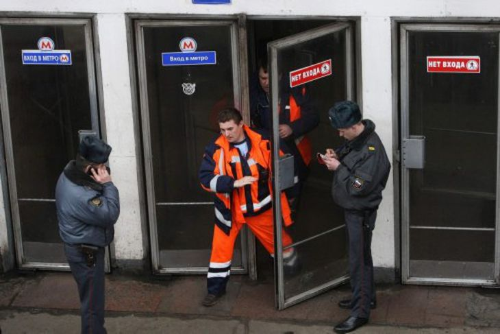 Emergencies Ministry members walk out from Park Kultury metro station in Moscow March 29, 2010. ...