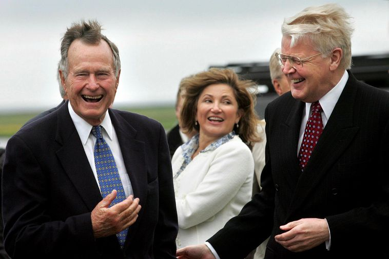 The presidential couple with US President George Bush.
