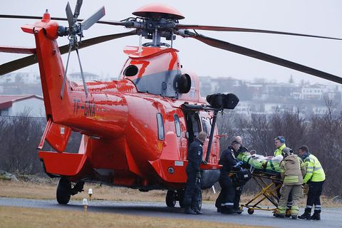 The survivors of the car accident being transported by helicopter from the scene of the accident.