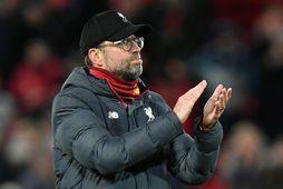 Jürgen Klopp og lærisveinar hans í Liverpool bíða eftir sínum fyrsta Englandsmeistaratitli í þrjátíu ár.