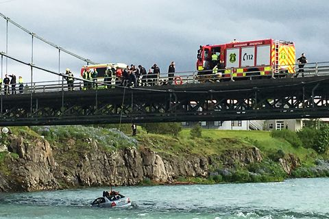 The driver was lucky to land in a shallow part of the river.