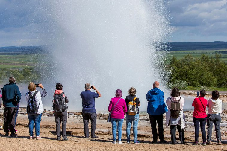 Tourists by Strokkur, South Iceland.