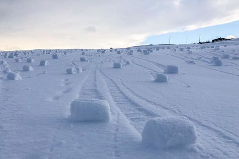 Snow rollers at the Keilir golf course yesterday.