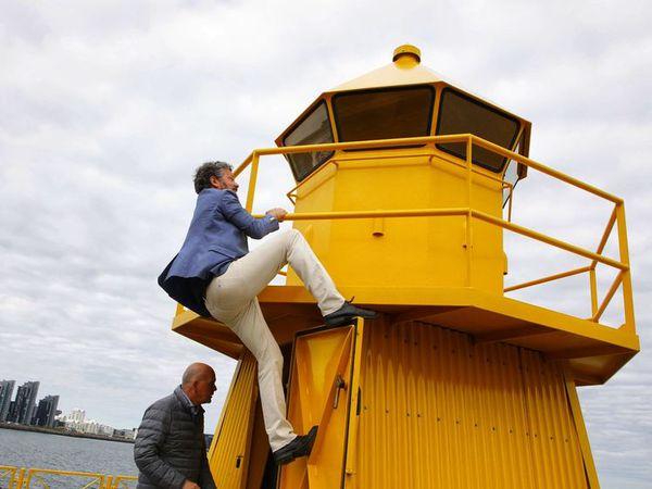 Dagur B. Eggertsson, climbing to the top of the lighthouse.