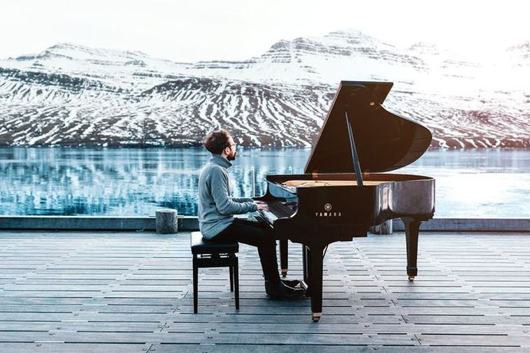 Costantino Carrara, playing the grand piano in Fáskrúðsfjörður, the East Fjords.