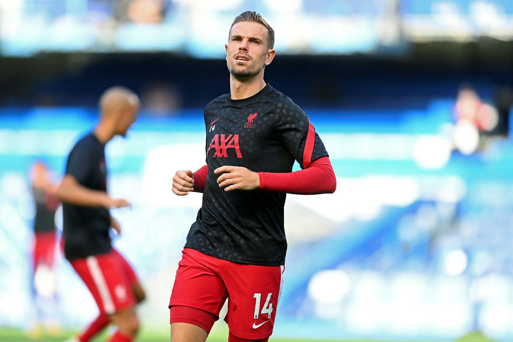 Jordan Henderson fór meiddur af velli í hálfleik gegn Chelsea …