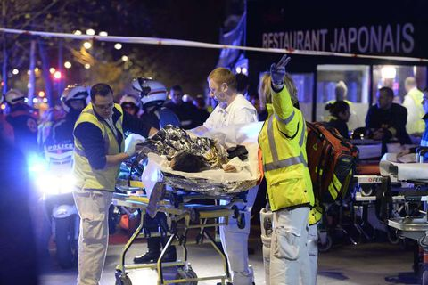 Paramedics at one of scenes of Friday night's terrorist attacks.