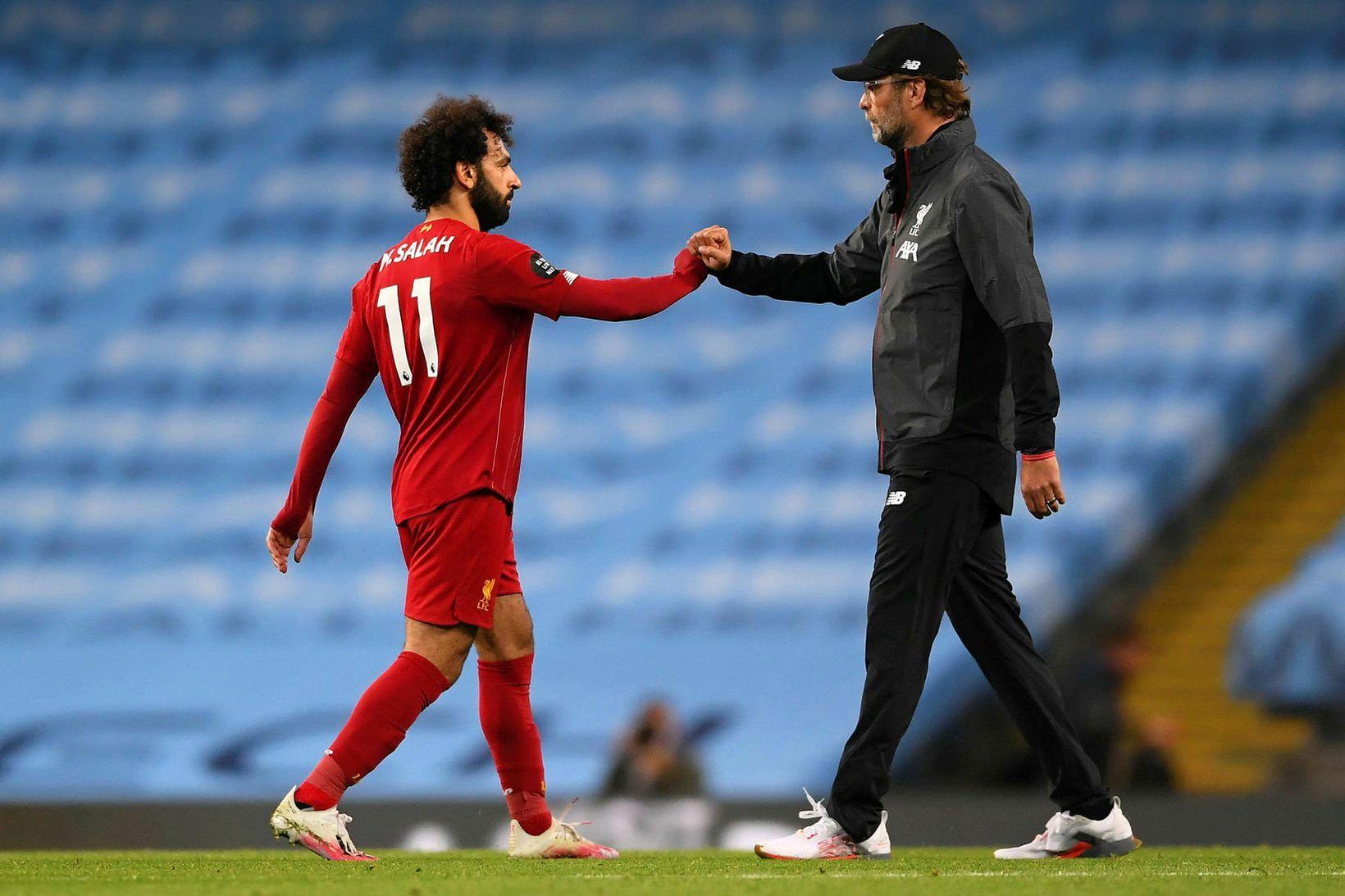 Mohamed Salah og Jürgen Klopp í leikslok.