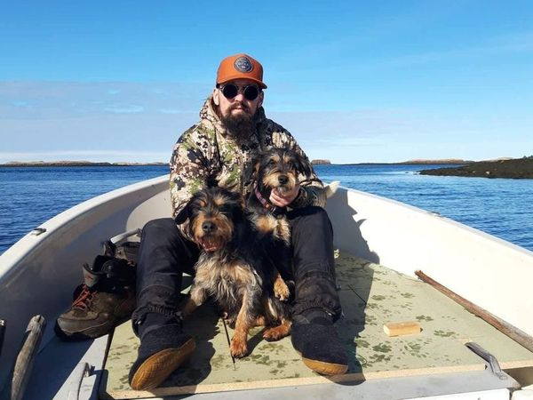 Snorri Rafnsson with his dogs in Breiðajörður fjord.