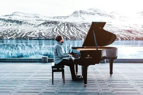 Costantino Carrara, playing the grand piano in Fáskrúðsfjörður, the East Fjords.