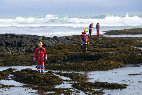 Rescue teams looking for evidence of Birna's clothing at the beach where her body was found.