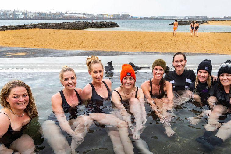 Happy women on Nauthólsvík geothermal beach.