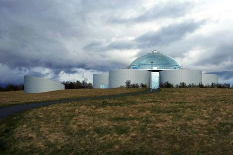 The Pearl in Reykjavik is a dome-shaped building on top of hot water tanks. The planetarium will rise adjacent to it.