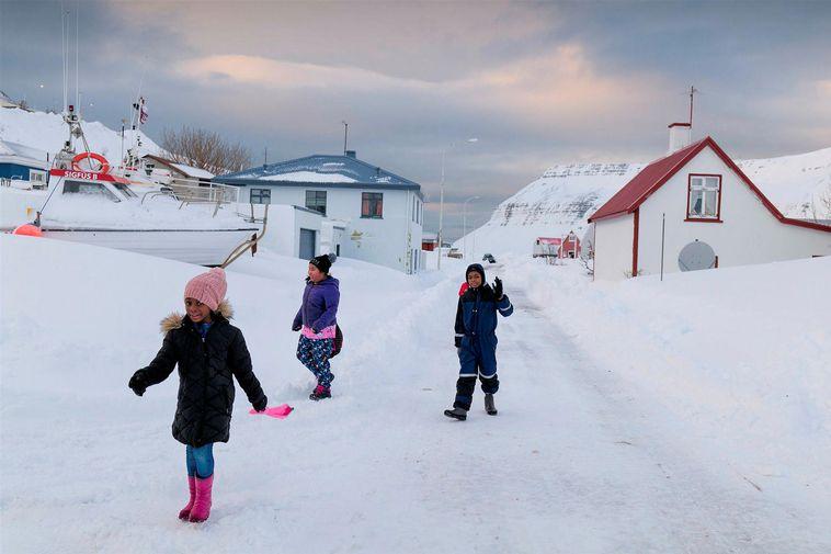 Children at play in Suðureyri yesterday.
