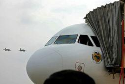 Airbus A320-232-vél Syrian Air var fyrsta farþegaflugvélin sem lenti á flugvellinum í Aleppo í átta …