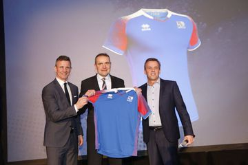 President Guðni Th. Jóhannsson (middle) during the presentation of the new shirt, which will be ...