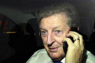 Roy Hodgson í símanum fyrir utan Wembley-leikvanginn í dag.