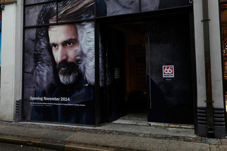 Baltasar Kormákur's face in the window of the new 66 north store in Copenhagen.