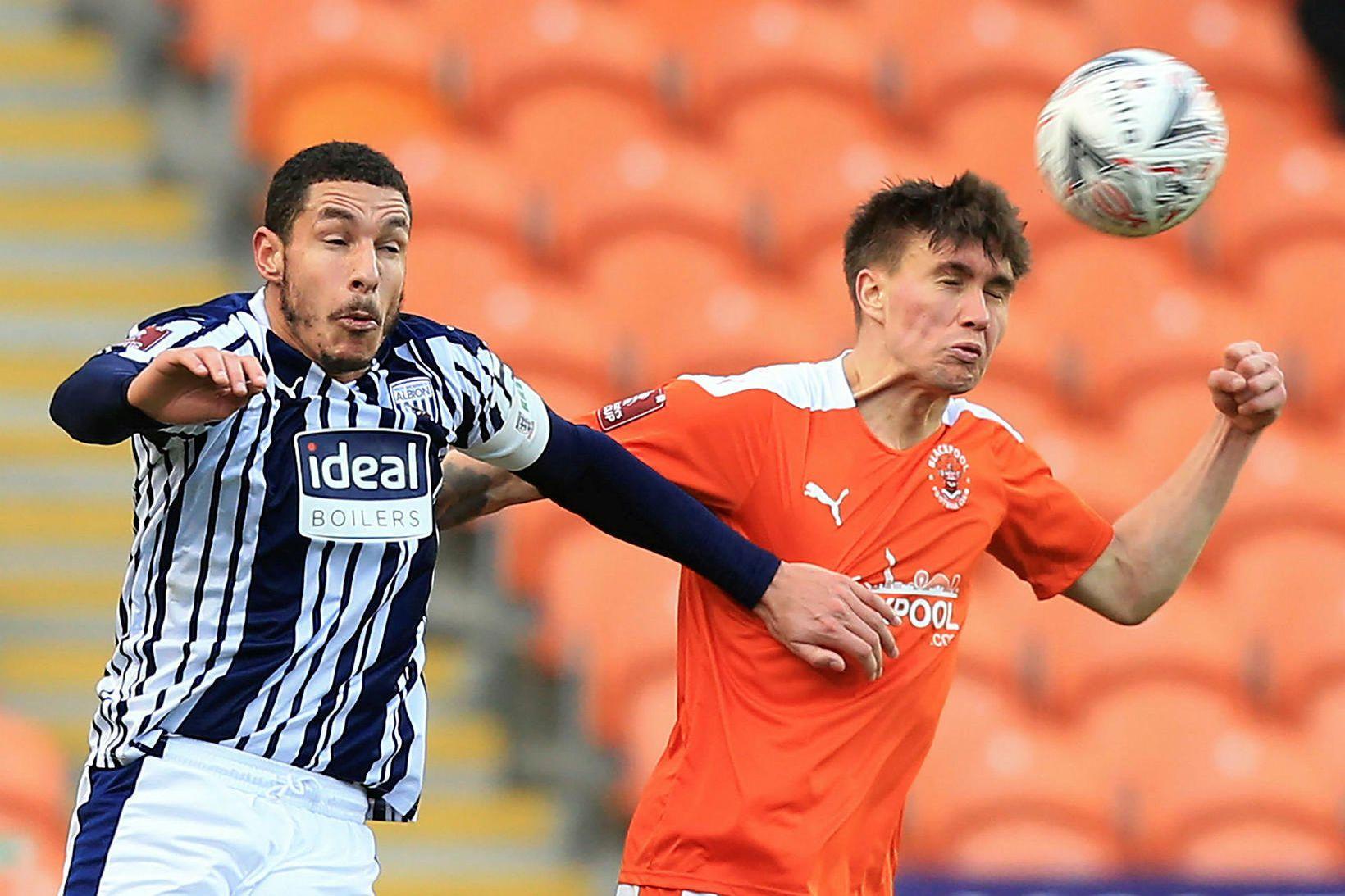 Daníel Leó Grétarsson í leik með Blackpool gegn WBA í …